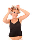 Young woman makes hair curlers funny Stock Photos