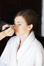 Young woman at makeup procedure in bathrobe Royalty Free Stock Photos
