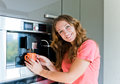 Young woman making coffee cup machine kitchen interior happy Royalty Free Stock Image