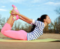 Young woman making fitness and yoga exercises on sand beach Royalty Free Stock Photo