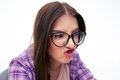 Young woman making funny face closeup portrait of a in glasses over white backgorund Royalty Free Stock Image