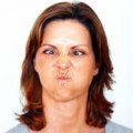 Young woman making a funny face over white Royalty Free Stock Photos
