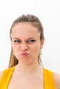 Young woman making a funny grimace expression Royalty Free Stock Photos