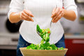 Young woman making salad Royalty Free Stock Photo