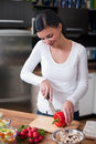 Young woman making vegetable salad Royalty Free Stock Photo