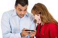 Young woman and man looking shocked with opened mouth on a cell phone reading an sms e mail or viewing latest news close up Royalty Free Stock Photos