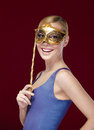 Young woman with masquerade mask Stock Image