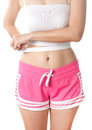 Young woman measuring her waistline with measuring tape beauty body care and diet Stock Photography