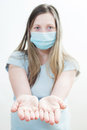 Young woman medical mask focus hands white background Stock Images
