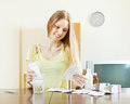 Young woman with medications at living room Stock Images
