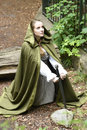 Young woman in medieval attire forest Stock Image
