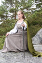 Young woman in medieval attire forest Stock Photos