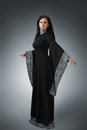 Young woman in medieval dress posing gothic style black Royalty Free Stock Images