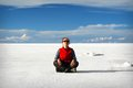 Young woman meditates in salar de uyuni at surface of salt lake bolivia Stock Image