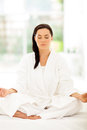 Young woman meditating beautiful in bedroom Royalty Free Stock Photo