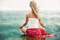 Young woman meditation on the beach blonde Royalty Free Stock Photography
