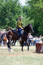 Young woman in military uniform rides a horse moscow june riders competition rider is dressed vintage Stock Image