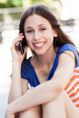 Young woman with mobile phone smiling Royalty Free Stock Photo