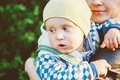 Young woman mother hugging her baby son outdoor spring portrait Royalty Free Stock Photos