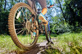 Young woman on mountain bike ride fast outdoors Stock Image