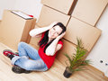 Young woman moving to new house Stock Images