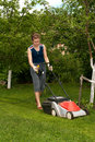 Young woman mow grass Royalty Free Stock Photo