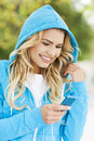 Young woman with mp player smiling Royalty Free Stock Image