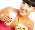 Young woman with muesli and milk happy glass of Stock Photography