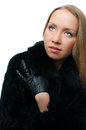 Young woman in a natural fur coat Royalty Free Stock Photography