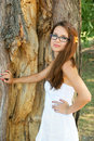 Young woman near big tree Stock Images