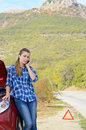 Young woman near broken car speaking by phone needs assistance Stock Image