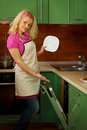 Young woman near the dishwasher Stock Photography