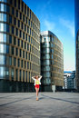 Young woman near office building on the background of the business buildings Royalty Free Stock Images