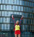 Young woman near office building rejoicing success on the background of the business Stock Photography
