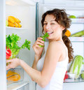 Young Woman near the Refrigerator Stock Photo