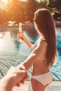 Young woman near swimming pool
