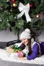 Young woman near xmas tree with presents pretty Stock Photos