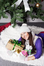 Young woman near xmas tree with presents pretty Royalty Free Stock Photos