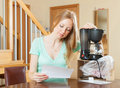 Young woman with new coffee machine at home happy Royalty Free Stock Photo