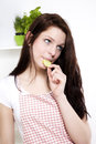 Young woman nibbling on a cucumber Royalty Free Stock Images