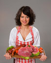 Young woman offers meat products Royalty Free Stock Photo