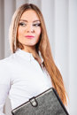Young woman office worker hold case with files. Royalty Free Stock Photo