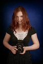 Young woman with old camera Royalty Free Stock Photo