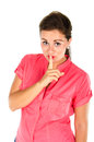 Young woman with one finger on her lips Royalty Free Stock Image