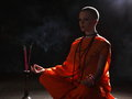 The young woman in orange robers in meditation Royalty Free Stock Photo