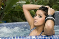 Young woman in an outdoor jacuzzi Stock Images