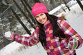 Young woman outdoor in winter plaing snawballs Stock Photography