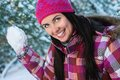 Young woman outdoor in winter plaing snawballs Royalty Free Stock Photo