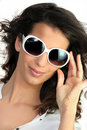 Young woman in oversized sunglasses Stock Images