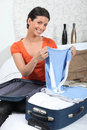 Young woman packing her luggage Stock Photography